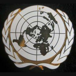 insigne métallique de béret plat de l'ONU
